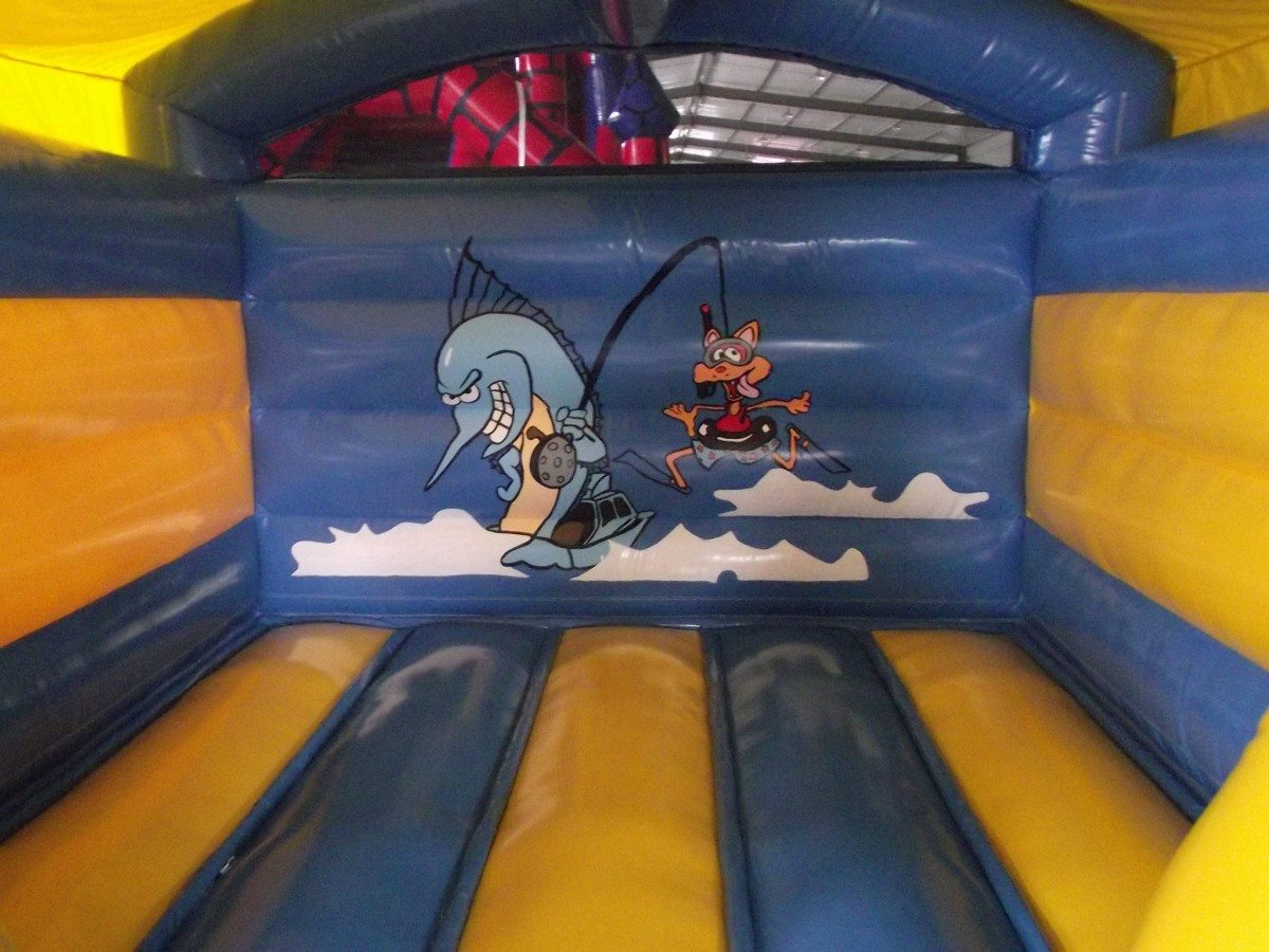 Indoor/outdoor low roofed bouncy castle hire inside picture
